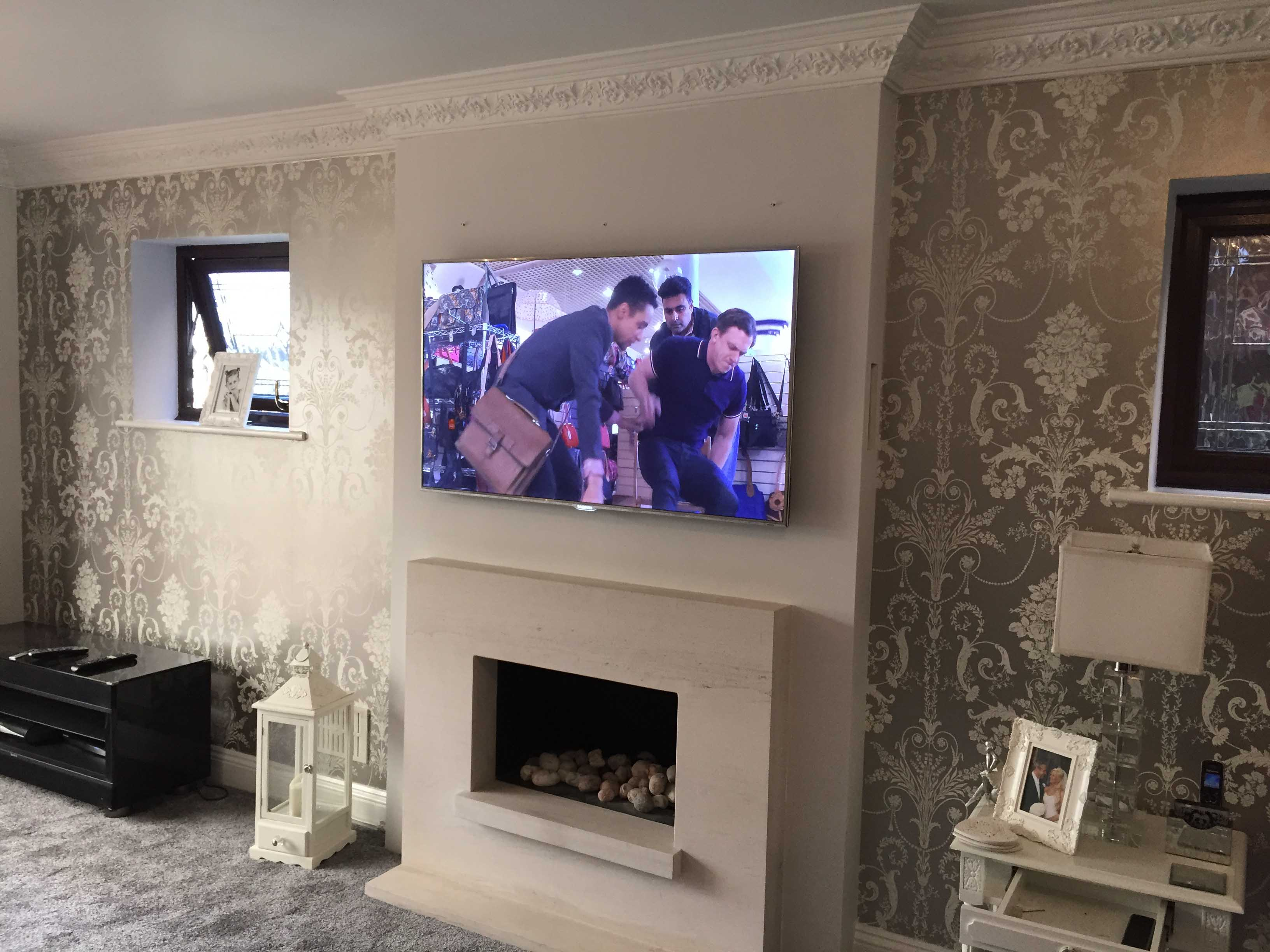 Should a TV be mounted over a fireplace?