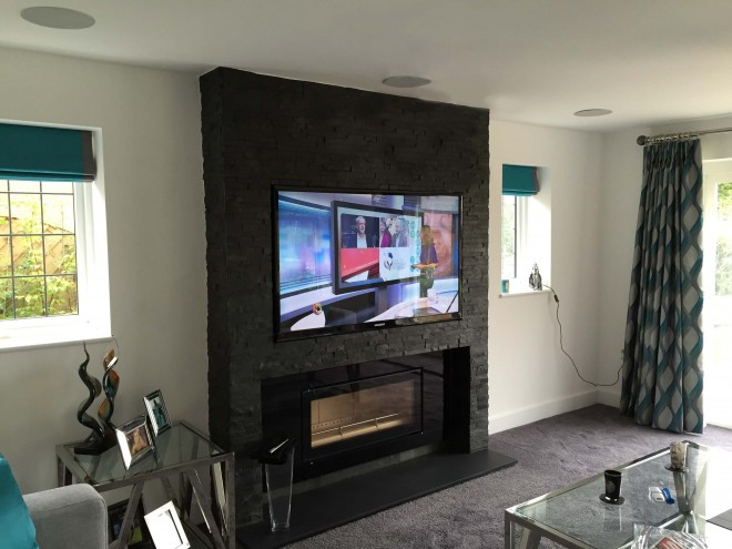 Recessed TV into fireplace with 5.1 surround sound